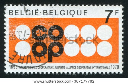 RUSSIA KALININGRAD, 20 OCTOBER 2015: stamp printed by Belgium, shows Cooperative Alliance Emblem, circa 1970 - stock photo