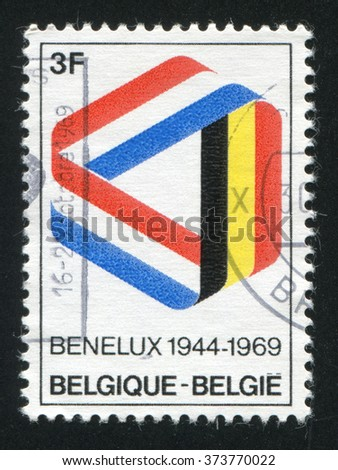 RUSSIA KALININGRAD, 18 OCTOBER 2015: stamp printed by Belgium, shows Ribbon in Benelux Colors, circa 1969 - stock photo
