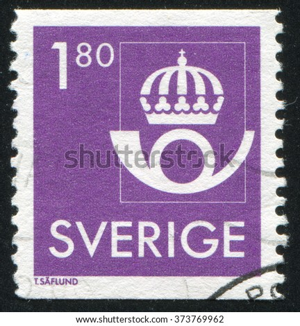 RUSSIA KALININGRAD, 8 SEPTEMBER 2013: stamp printed by Sweden, shows Crown and post horn, circa 1985 - stock photo