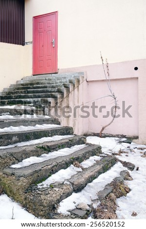 RUSSIA, KALUGA REGION, KOZELSK - FEBRUARY, 23: old curve of the stairs on the street - stock photo