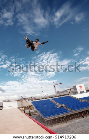 Russia, Moscow, August 18, 2016: Skateboarder making a stunt in quarter pipe ramp at Russian X Challenge 2016 contest, Moscow, Russia
