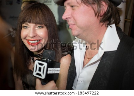 RUSSIA, MOSCOW - DEC 15, 2013: Alisa Mon with friend gives interviews to Music Box in Arena Moscow. Alisa Mon - Soviet and Russian pop singer.