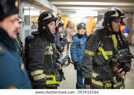 RUSSIA, MOSCOW - 26 FEB, 2015: Many firefighters in uniforms are training at Preobrazhenskaya ploshchad subway.