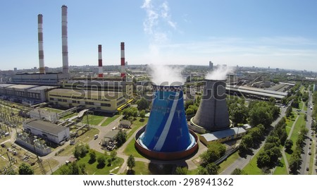 RUSSIA, MOSCOW - JUL 14, 2014: Electricity station at summer sunny day. Aerial view. Photo with noise from action camera. - stock photo