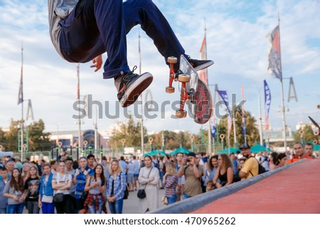 Russia, Moscow, July 23, 2016: fragment of a skateboarder, who makes ollie stunt at Moscow City Games contest, Luzhniki, Moscow, Russia