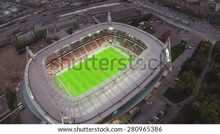 RUSSIA, MOSCOW - 28MAR, 2014: Aerial view of Illuminated soccer arena Locomotive. - stock photo