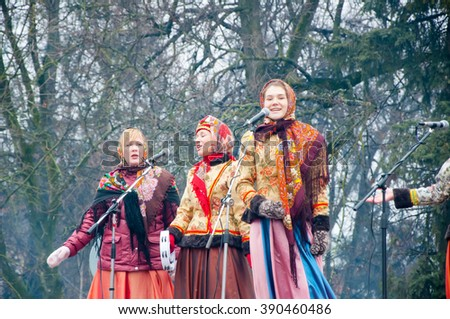 RUSSIA, MOSCOW-MARCH 13: The group of women in traditional Russian clothes sing a song on Maslenitsa on March 13, 2016 in Moscow. Maslenitsa is a week-long festival before Great Fast. - stock photo