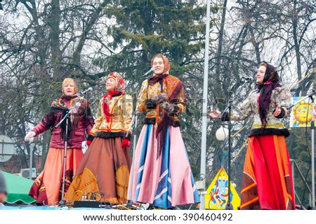 RUSSIA, MOSCOW-MARCH 13: The group of women wearing traditional Russian clothes sing a song on Maslenitsa on March 13, 2016 in Moscow. Maslenitsa is a week-long festival before Great Fast. - stock photo