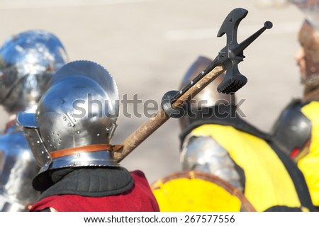 RUSSIA, MOSCOW - MARCH 14: Unidentified knight hold an axe on a shoulder on history reenactment of the Medieval maneuvers in Moscow, 14 March, 2015, Russia