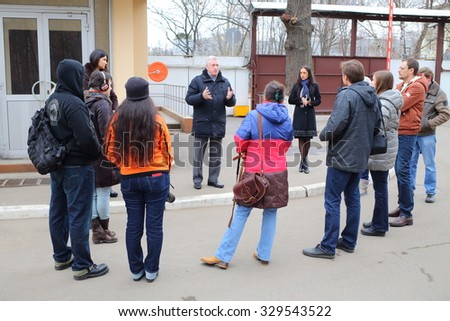 RUSSIA, MOSCOW - NOV 14, 2014: Chairman of the Council of Veterans Alexander Yarovikov is speaking to bloggers in North-East district of Moscow. - stock photo