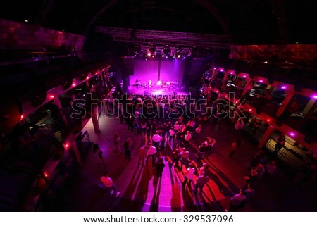 RUSSIA, MOSCOW - NOV 30, 2014: Many people are watching performance of Kazaky band. - stock photo