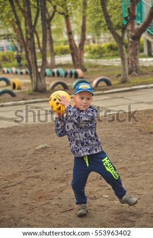 Russia, Nizhny Tagil. Children in kindergarten, preschool training and development. Games outside on the Playground.