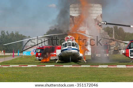 RUSSIA, NOGINSK - AUGUST 7, 2015: Demonstration performances of rescuers of Ministry of Emergency Situations of Russia. Fire extinguishing on aviation equipment.