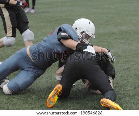 RUSSIA, PODOLSK CITY - JULY 27: Zurab Stankidze (95 black) fights on friendship football game Spartans vs Vityazi on July 27, 2013, in Moscow region, Podolsk city, Russia - stock photo