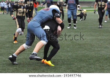 RUSSIA, PODOLSK CITY - JULY 27: Zurab  Stankidze (95, black) in action on friendship football game Spartans vs Vityazi on July 27, 2013, in Moscow region, Podolsk city, Russia - stock photo