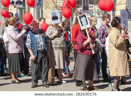 RUSSIA, ROSTOV CITY - MAY 9: Unidentified people walk on Victory day parade dedicated 70 anniversary of WWII end on May 9, 2015, in Yaroslavl region, Rostov the Great city, Russia