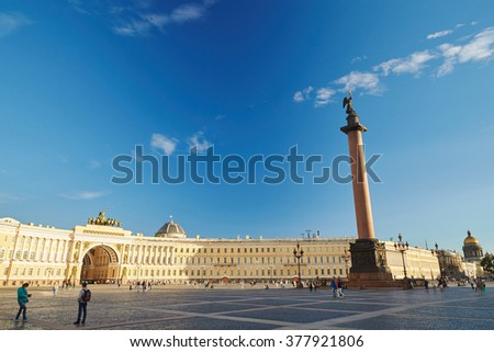 Russia, Saint-Petersburg, 14 aug 2015: Palace Square and the Alexander Pole, Column, sunset,  clouds, a lot of people in the square, wet cobbles