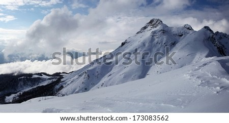 Russia. Sochi. Krasnaya Polyana. Top of Aibga Ridge in snow. - stock photo