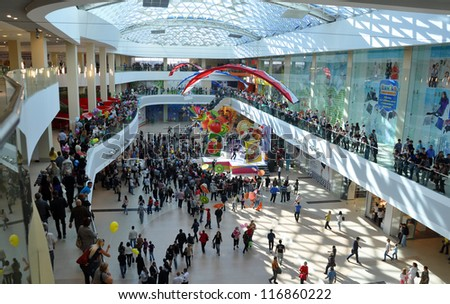 """RUSSIA, SOCHI - OCTOBER 27: A crowd of people shopping in the shopping center """"Moremoll"""" on the opening day on OCTOBER 27, 2012, Sochi, Russia. The investment amounted to 7.5 billion rubles - stock photo"""