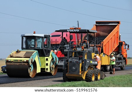RUSSIA, TAMBOV - August, 23, 2016: Asphalt paver machine and heavy machinery during repairs road under the program repairs highway road