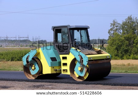 RUSSIA, TAMBOV - August, 23, 2016: Road roller at a road construction site . Side view