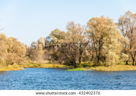 Russia Tatarstan Kama River Fall. Multi-coloured fall foliage along a river.