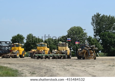 Russia, Temryuk - 15 July 2015: Tractor, standing in a row. Agricultural machinery. Parking of agricultural machinery. - stock photo