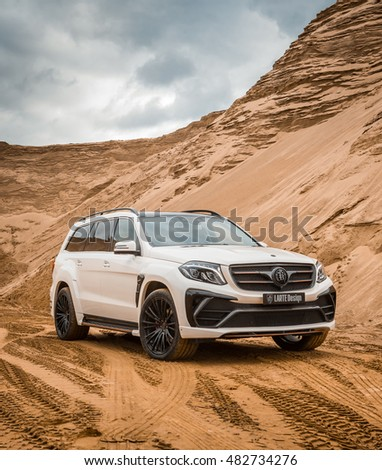 Russia, Togliatti - September 9, 2016: Test drive of Mercedes GLS with tuning kit Black Crystal of LARTE Design Tuning Company. Sand quarry at the background. Traces of the protectors