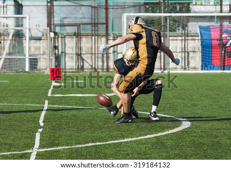 RUSSIA, TROITSK CITY - JULY 11: S. Kalashnikov (8) on free shot during Russian american football Championship game Spartans vs Raiders 52 on July 11, 2015, in Moscow region, Troitsk city, Russia - stock photo