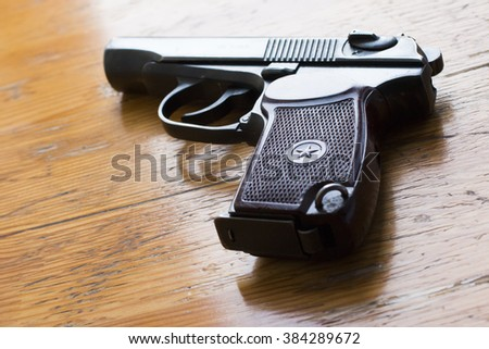 Russian armed army gun on a wooden table - stock photo