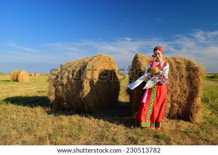 Russian beauty with bread in the hayloft - stock photo