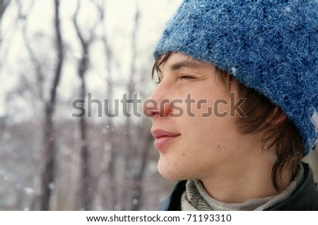russian boy wearing fur with snow  in winter