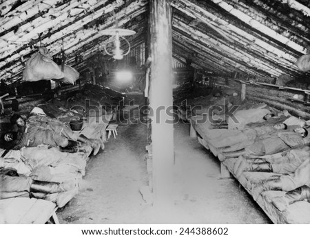 Russian convicts' sleeping quarters in a primitive Siberian prison camp barracks. Khabarovsk area in far eastern Russia near the Chinese border. Ca. 1895 photo by William Henry Jackson. - stock photo