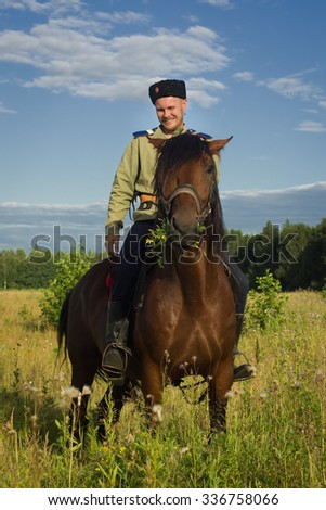 Russian Cossack uniformed WWI inspecting the border on horseback