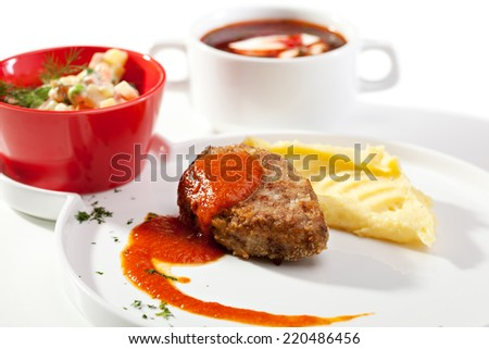 Russian Dinner - Vegetable Salad, Cutlet with Mashed Potato, Beetroot Soup - stock photo