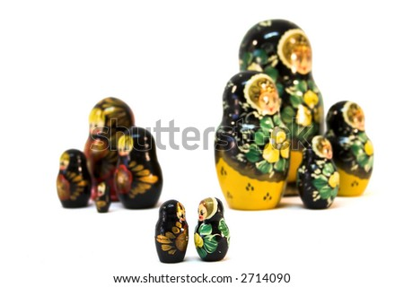 Russian dolls playing Romeo and Juliet, with family conflict in background. - stock photo