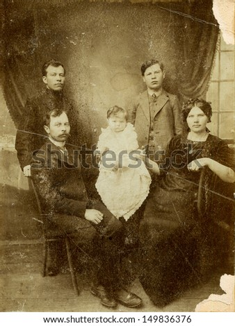 RUSSIAN EMPIRE - CIRCA 1900s: Antique photo shows family, 1900s