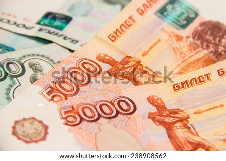 Russian five thousand and one thousand ruble banknotes roll-up. Close-up - stock photo