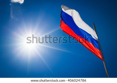 Russian flag on blue sky background - stock photo
