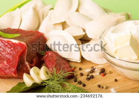 Russian folk kitchen cooking dumplings - stock photo
