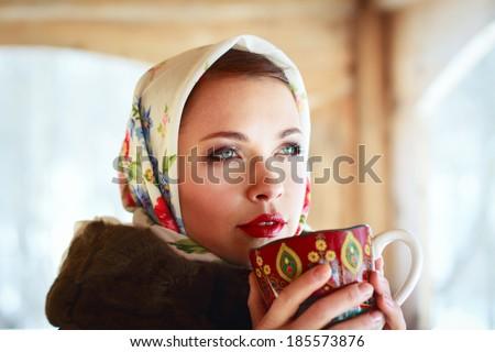 Russian girl drinking tea in the village - stock photo