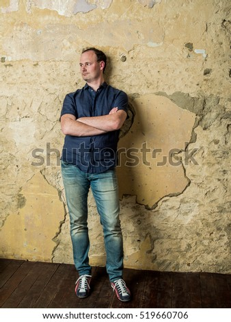 Russian man in a suit on old peeling wall in grunge style