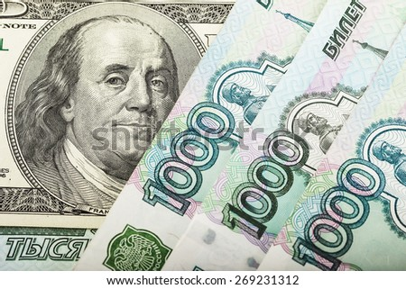 Russian money and one hundred dollars. concept - stock photo
