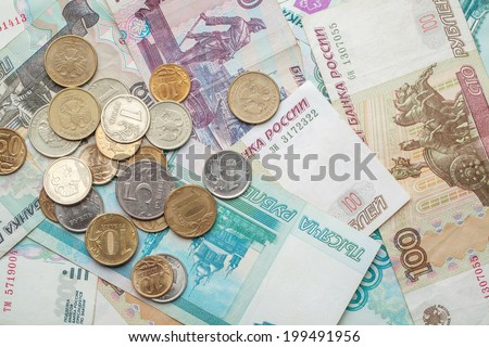 Russian money background. Rubles banknotes and coins - stock photo