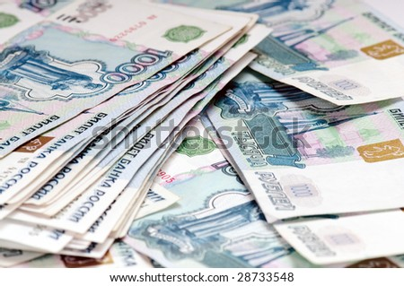 Russian money - pile of 1000 ruble banknotes - stock photo