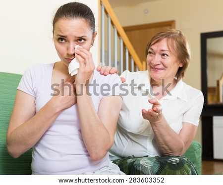 russian mother and  adult daughter  after quarrel  in  living room - stock photo