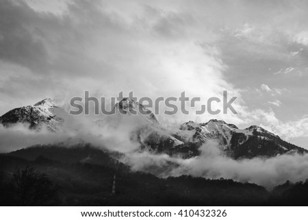 Russian mountains in black and white, mountains immersed in the clouds