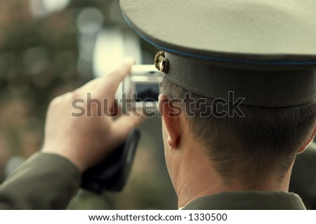 russian officer with digital camera