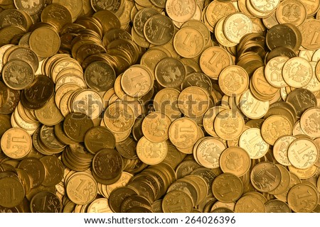 Russian one ruble coins background in gold color - stock photo