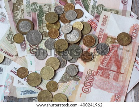 Russian paper and metal money on wooden table, top view. Rubles and kopecks.